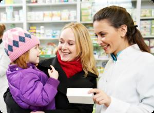 male pharmacist assisting a female customer