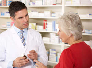 Pharmacist helping the elderly customer