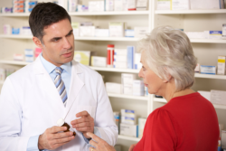 pharmacist assisting an elderly woman